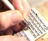 Writing Mezuzah by Sofer Stam.To enlarge, click here